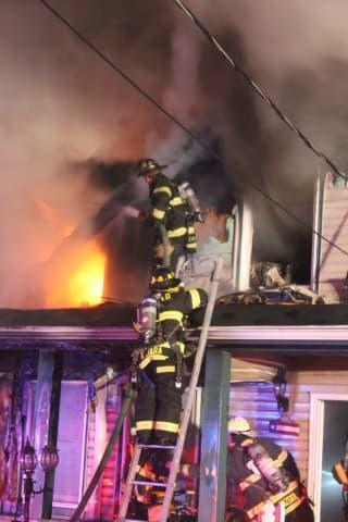 PHOTOS: Car Fire Spreads To Garfield Home