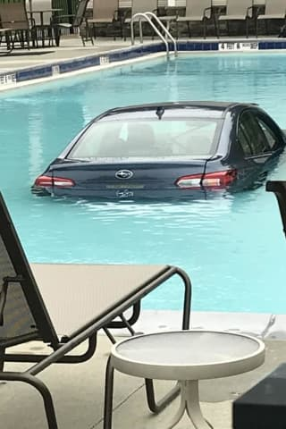 Woman Hits Gas Instead Of Brake, Ends Up In Pool, Police Say